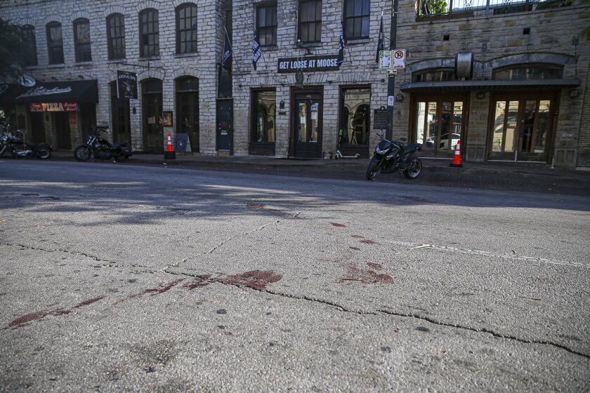 Blood stains remain on 6th Street after an early morning shooting on Saturday in downtown Austin.