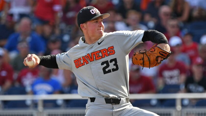 Oregon State's Kevin Abel (23) pitching in decisive game of the College World Series in June 2018.