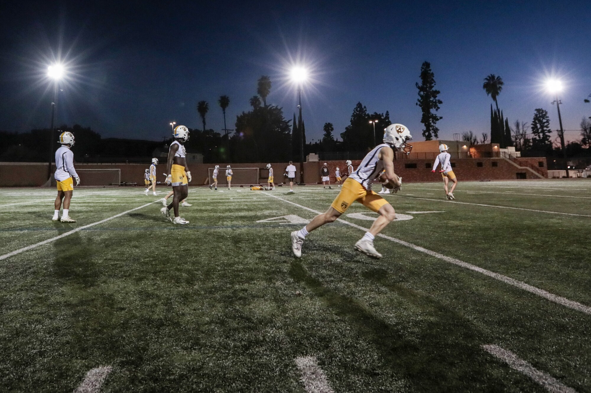 Crespi High School players practice for the first time since COVID-19 restrictions shut down interscholastic sports.