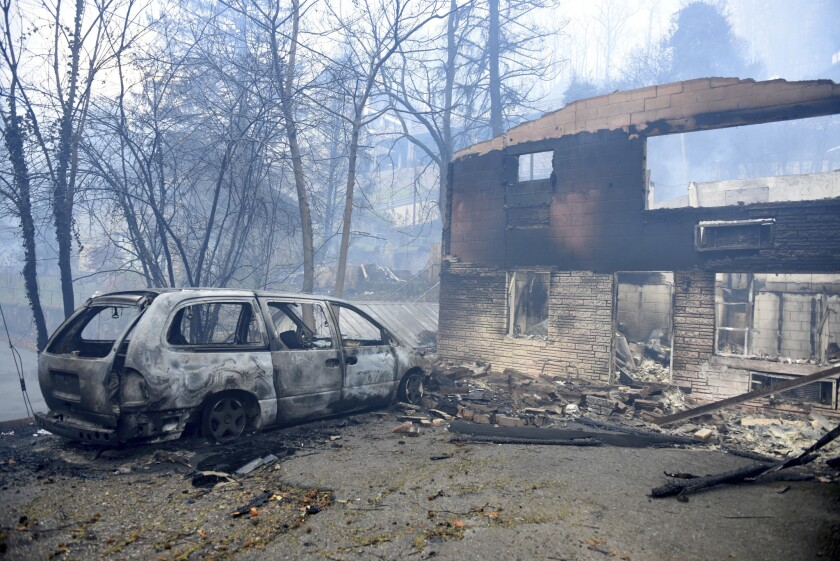 A home and van destroyed by fires raging around Gatlinburg, Tenn., on Nov. 29.
