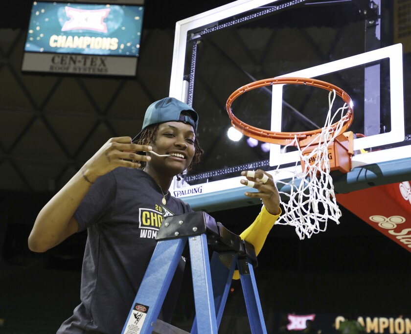 Baylor forward NaLyssa Smith cuts down the net after defeating Kansas State, in an NCAA college basketball game, Saturday, Feb. 27, 2021, in Waco, Texas. Baylor celebrated their 11th consecutive Big 12 regular season title and its 12th overall. (Rod Aydelotte/Waco Tribune Herald via AP)