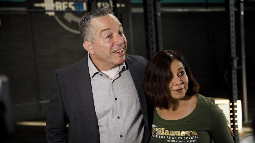 LA County Sheriff candidate Alex Villanueva speaks to the media alongside his wife Vivian Villanueva