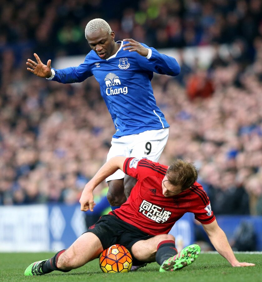 West Bromwich Albion's Craig Dawson and Everton's Arouna Kone, top, battle for the ball during the English Premier League soccer match at Goodison Park, Liverpool, England, Saturday Feb. 13, 2016. (Martin Rickett/PA via AP) UNITED KINGDOM OUT