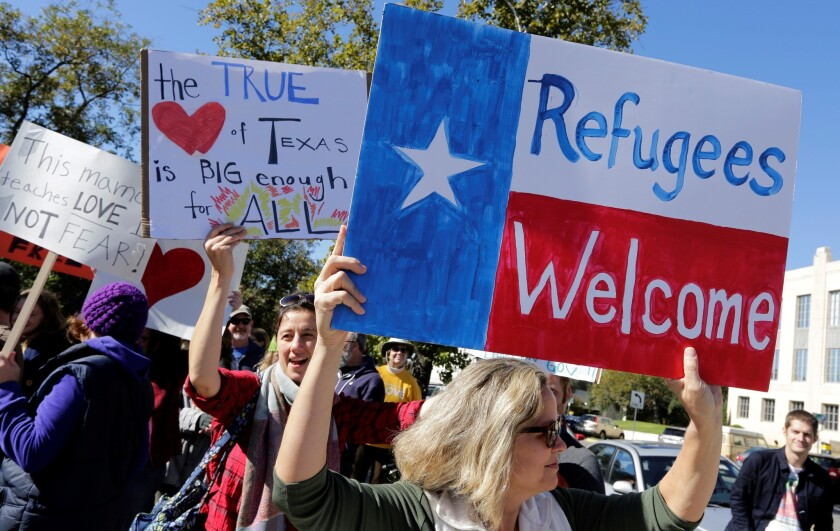 Members of The Syrian People Solidarity Group protest in Austin, Texas.