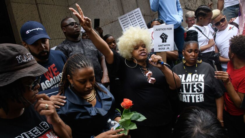 More than 200 people gather for a rally at the Allegheny County Courthouse in Pittsburgh on June 21 to protest the fatal shooting of an unarmed black teen.