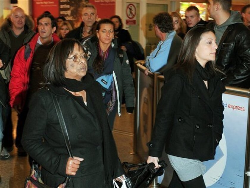 Arline Kercher, the mother of murdered student Meredith Kercher and daughter Stephenie, right, arrive at Stansted Airport, London after their flight from Perugia in Italy Sunday Dec. 6, 2009. The family of murdered British student Meredith Kercher returned home pledging to try and get on with their lives. A jury in Italy convicted Amanda Knox of murdering her British roommate Meredith Kercher and sentenced her to 26 years in prison shortly after midnight Saturday. Her Italian ex-boyfriend Raffaele Sollecito was also convicted and sentenced to 25 years. (AP Photo/John Stillwell/PA Wire)