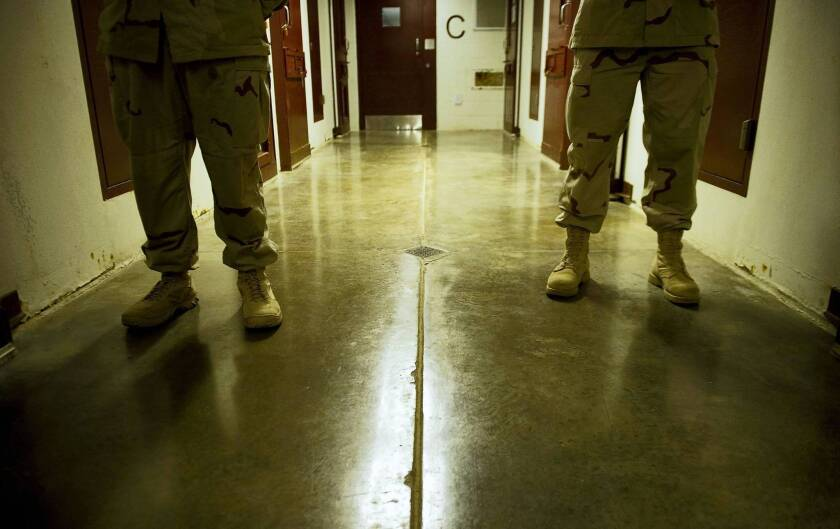Navy personnel on duty at the U.S. military prison at Guantanamo Bay last year. More than half the prisoners are from Yemen.