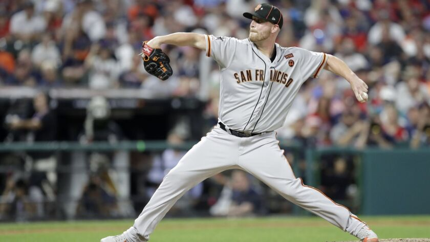National League pitcher Will Smith, of the San Francisco Giants, throws during the seventh inning of