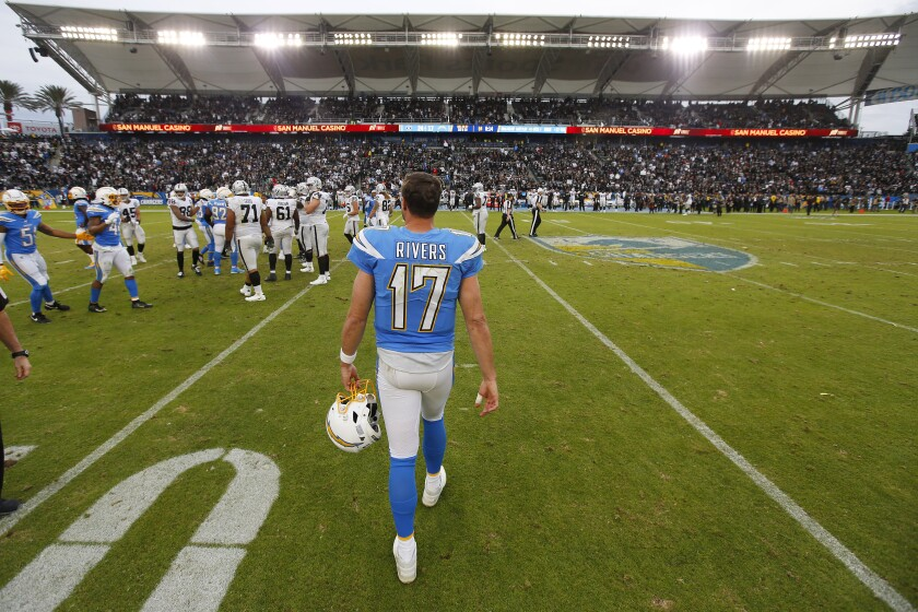Chargers quarterback Philip Rivers walks off the field after a 24-17 loss to the Oakland Raiders on Sunday.