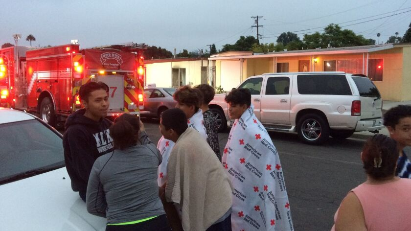 Some of the children who escaped a fire at the Oak Park home wrapped up in Red Cross blankets Wednes