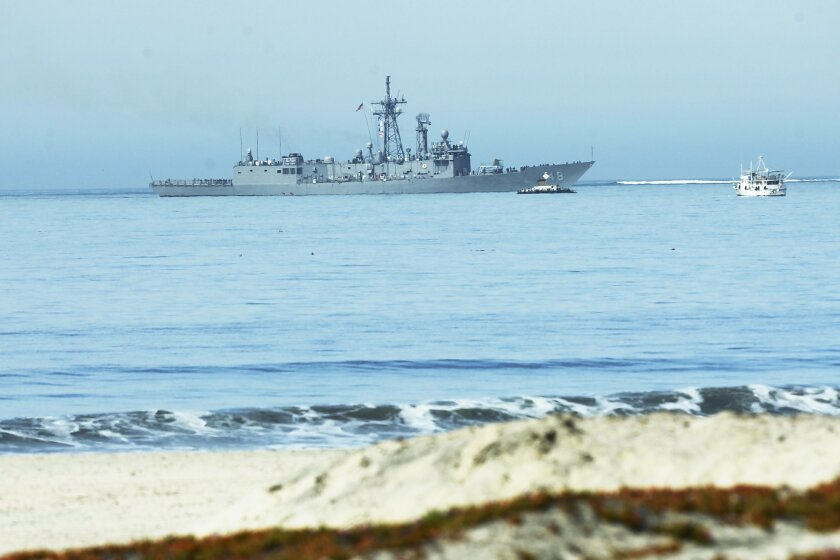 The USS Vandegrift pulls into San Diego Bay with the Kaufman family aboard who were rescued at sea.
