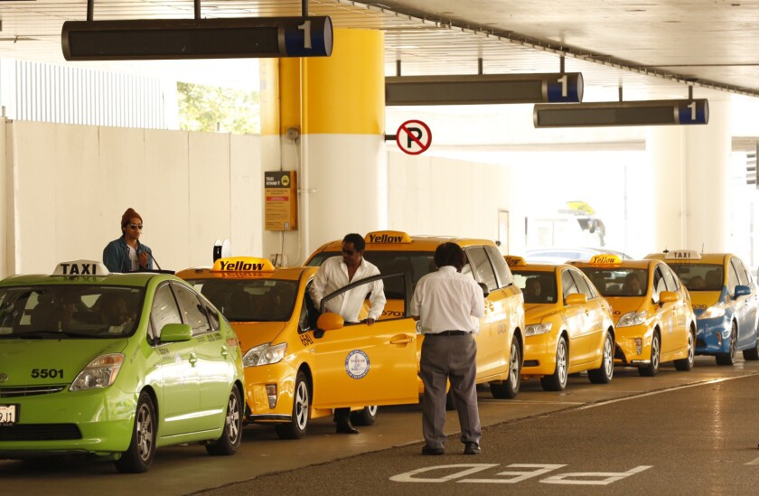 Taxis wait in line at LAX Terminal One on Thursday.
