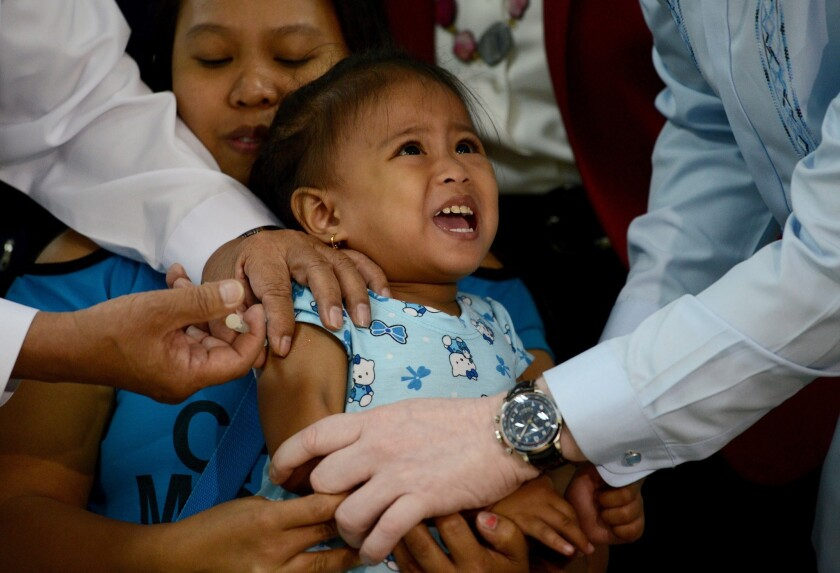 A girl in the Philippine capital of Manila is vaccinated against measles on Friday. The country is experiencing a large outbreak of the disease. Fifteen Californians have come down with measles thus far this year, officials said.