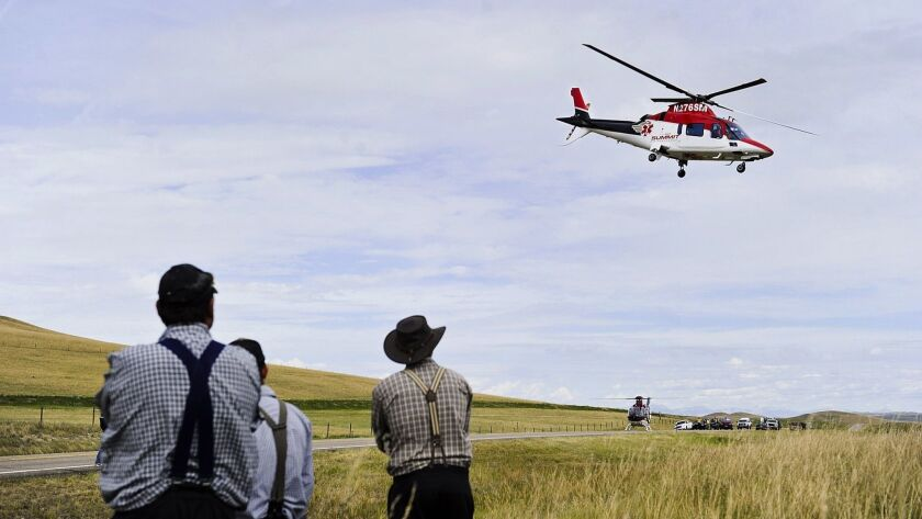 An emergency helicopter flies over the scene of a fatal collision in Montana in 2015.