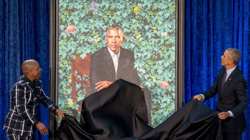 President Obama and artist Kehinde Wiley unveil Obama's portrait at the Smithsonian's National Portrait Gallery in Washington, D.C., in 2018.