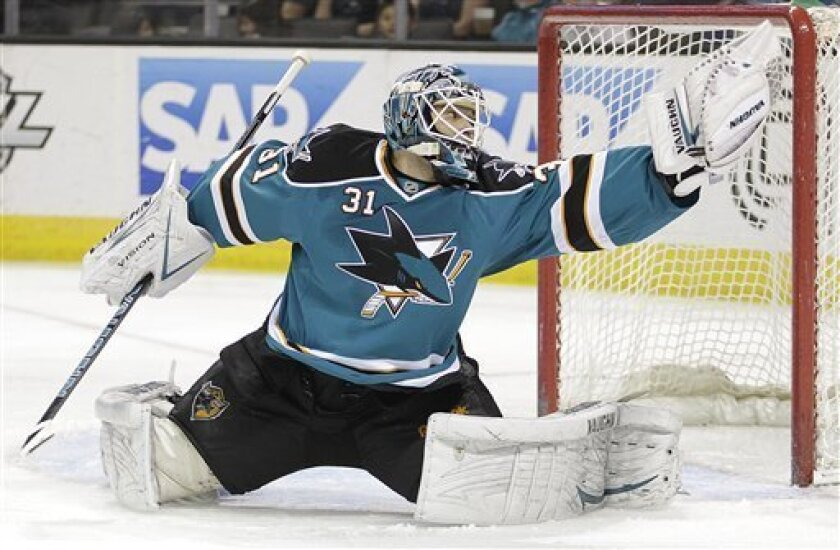 San Jose Sharks goalie Antti Niemi deflects a shot from the Dallas Stars during the first period of an NHL hockey game Saturday, March 31, 2012, in San Jose, Calif. (AP Photo/Ben Margot)