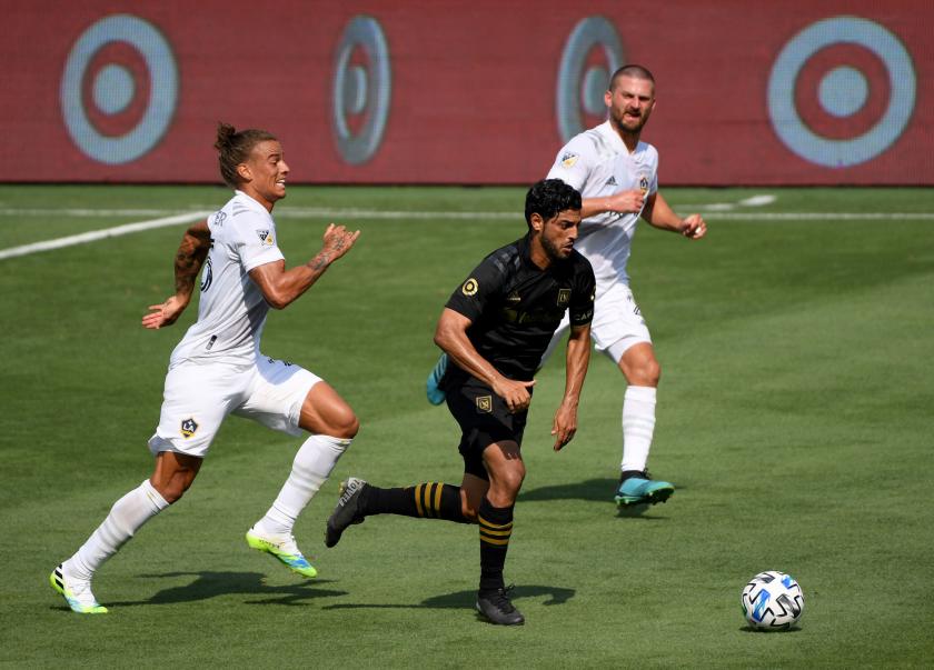 LOS ANGELES, CALIFORNIA - AUGUST 22: Carlos Vela #10 of Los Angeles FC controls the ball.