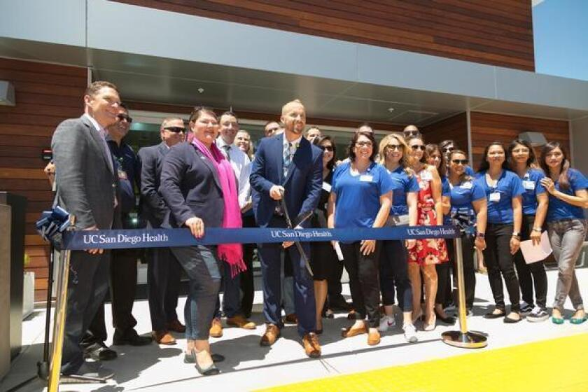 Members of UC San Diego Health and 76th District State Assemblymember Tasha Boerner Horvath (with a pink scarf) celebrate the opening of UC San Diego Health's Encinitas clinic at 1505 Encinitas Blvd. To learn more, call (858) 657-7000 or visit health.ucsd.edu