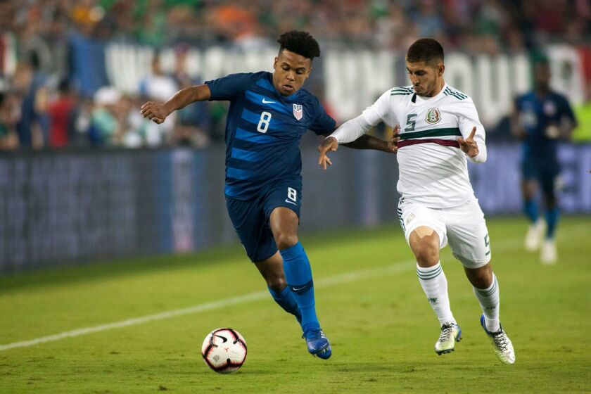 Weston McKennie of the U.S., left, and Mexico's Victor Guzman play Sept. 11 at Nissan Stadium in Nashville.