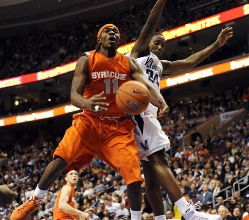 Syracuse's Paul Harris (11) is fouled by Villanova's Corey Stokes during the first half of an NCAA college men's basketball game at the Wachovia Center in Philadelphia, Saturday, Feb. 07, 2009. (AP Photo/Michael Perez)