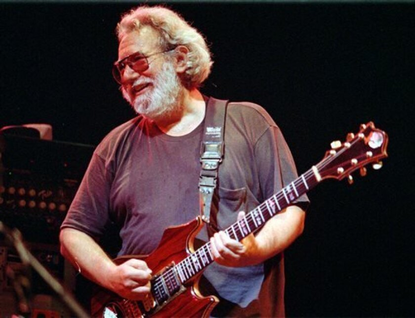 FILE - This Nov. 1, 1992 file photo shows Grateful Dead lead singer Jerry Garcia performing in Oakland , Calif. The San Francisco Chronicle reports more than 1,100 people have signed an online petition opposing any name change to Jerry Garcia Amphitheater in Excelsior, near where the late guitarist