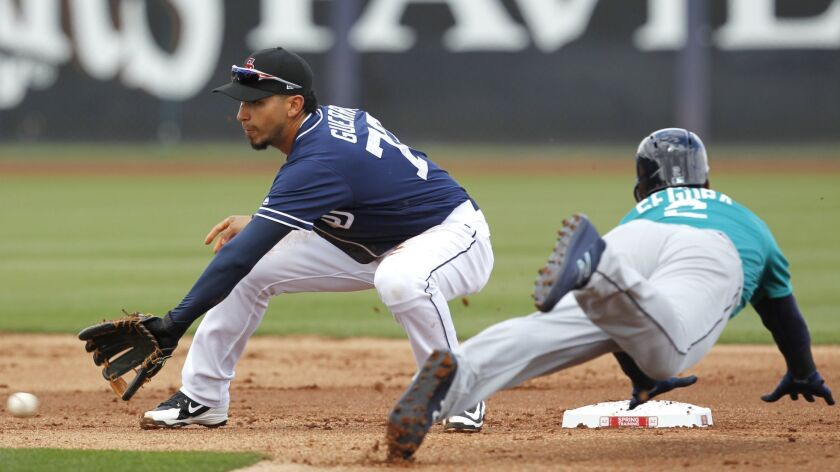 A ball gets by San Diego Padres Javy Guerra as Seattle Mariners Jean Seager steals second base during a spring training game in Peoria on Feb. 23, 2018.