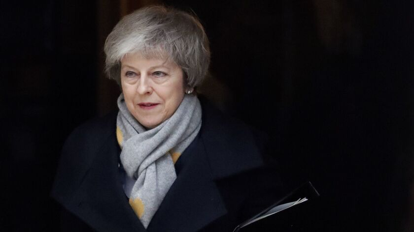 Britain's Prime Minister Theresa May leaves a cabinet meeting at Downing Street in London, Tuesday,