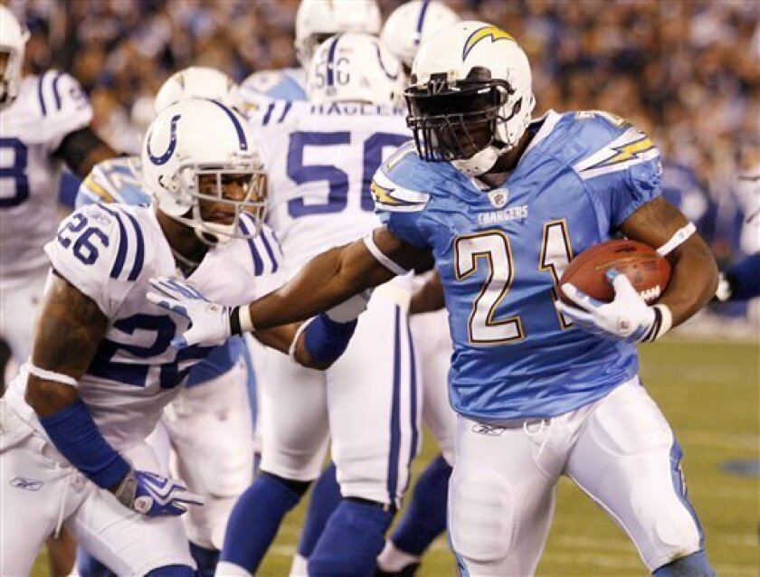 San Diego Chargers running back LaDainian Tomlinson, right, scores around Indianapolis Colts cornerback Kelvin Hayden during the second quarter an NFL AFC wild-card playoff football game Saturday, Jan. 3, 2009 in San Diego. (AP Photo/Denis Poroy)