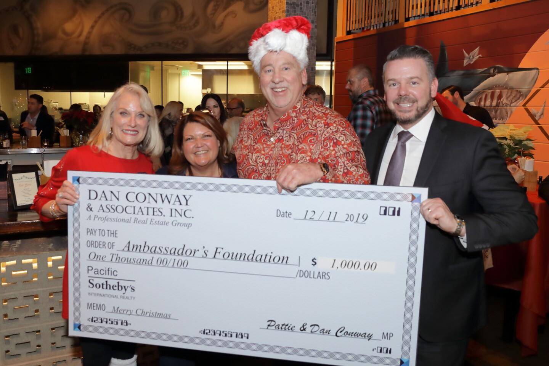 Pattie (far left) and Dan Conway (center right) present a check to AmbassadorÕs Foundation representatives Chris Anderson (center left) and Ryan Maxson (far right)