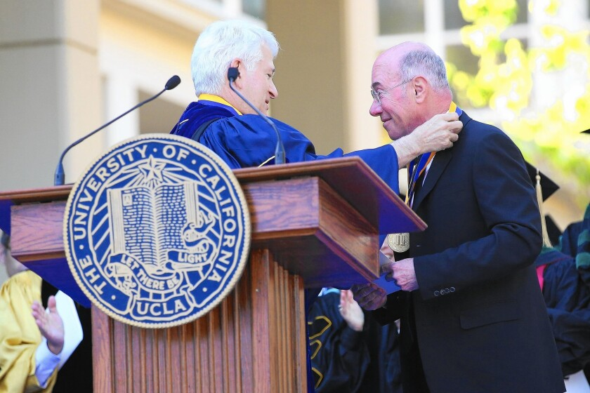 "UCLA Chancellor Gene Block, left, presents an award to David Geffen in 2014. Block said that Geffen's latest gift to establish a private middle and high school will fill ""a significant need, and not just UCLA's need."""
