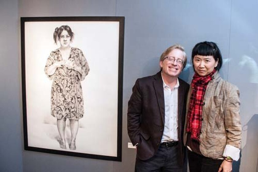 'wonder of women' exhibition, guest juror robert Pincus poses with curator Li Huai and the grand-prize-winning self portrait by Angela Dominguez Burns. Maurice Hewitt