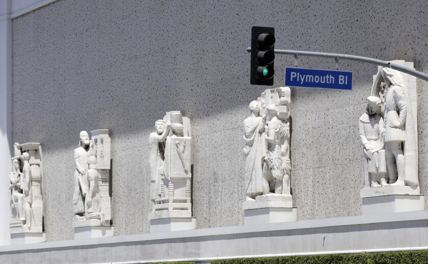 Sculptures of historic figures front the Scottish Rite Masonic Temple.