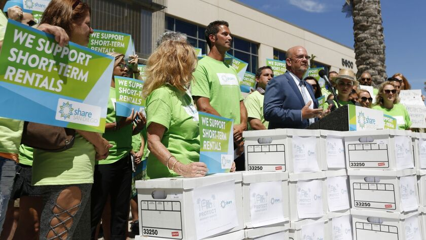 San Diego City Councilman Scott Sherman speaks at a news conference before more than 62,000 signatures were delivered to the San Diego Registrar of Voters to qualify a referendum that would overturn short-term rental regulations passed this month by the San Diego City Council.