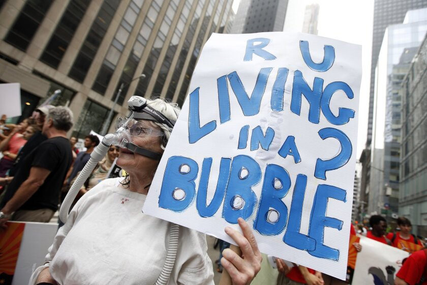 Demonstrators make their way down Sixth Avenue in New York during the People's Climate March on Sept. 21, 2014.