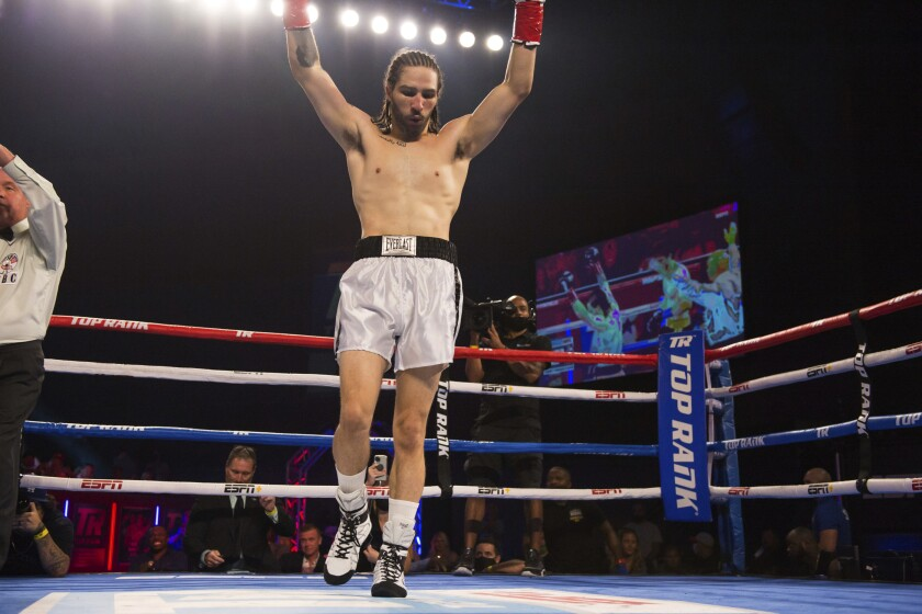 Nico Ali Walsh celebrates after defeating Jordan Weeks during a middleweight boxing bout Saturday, Aug. 14, 2021, near Tulsa, Okla. (Brett Rojo/Tulsa World via AP)