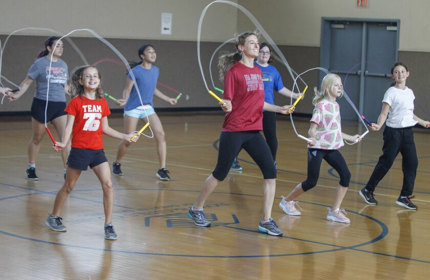 Summer Beeson (fourth from left) practices jump rope routines with The Coronado Speed Spinners jump rope team.