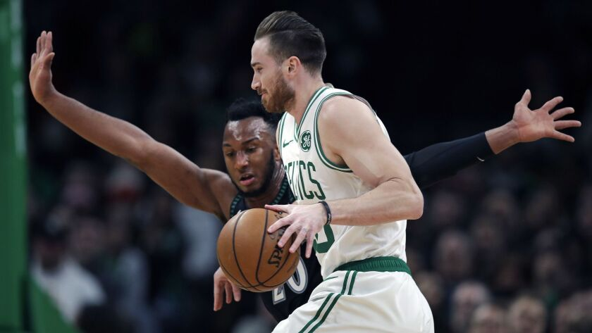 Boston Celtics forward Gordon Hayward, right, tries to drive past Minnesota Timberwolves guard Josh Okogie, front, during the first quarter.