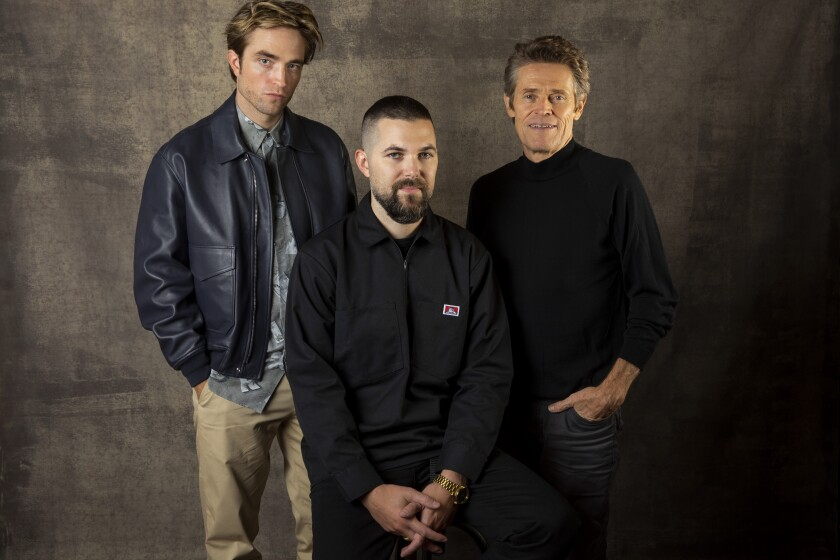 """Actor Robert Pattinson, director Robert Eggers and actor Willem Dafoe, from the film """"The Lighthouse,"""" photographed in the L.A. Times Photo Studio at the 2019 Toronto International Film Festival."""