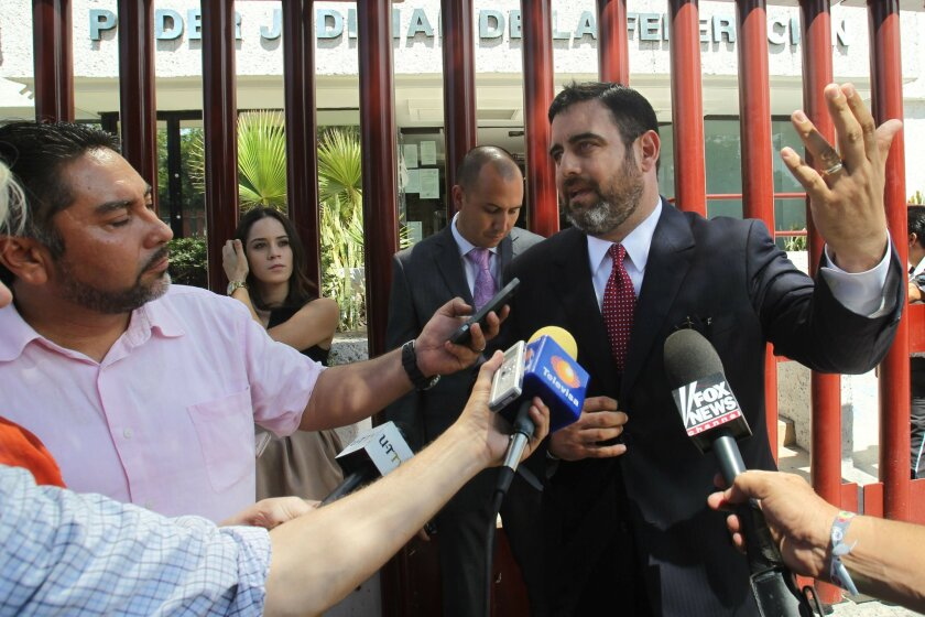 Fernando Benitez, attorney for Andrew Tahmooressi, talks to reporters outside the federal courthouse in Tijuana on Wednesday.