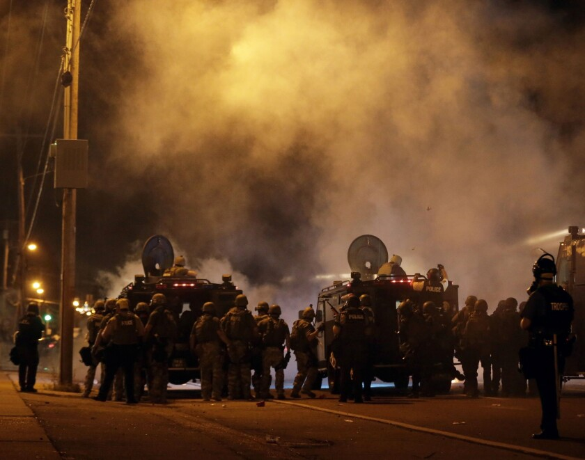Police on the streets of Ferguson, Mo., on Sunday night.