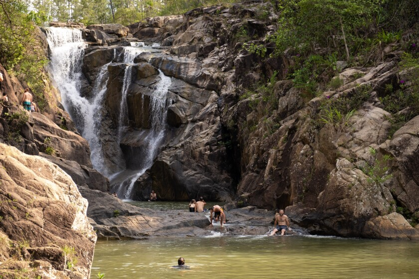 Brave visitors lunge from rocky cliffs at Big Rock Falls. Or you can wade to the cascade for a free neck massage, compliments of nature.