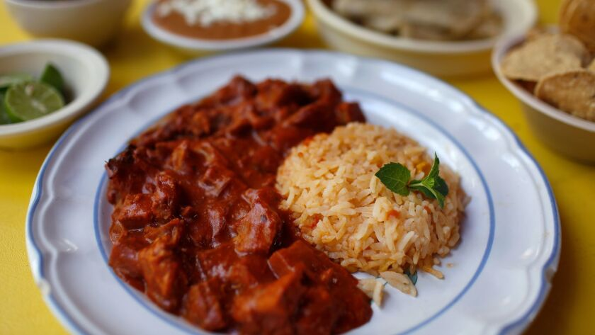 HERMOSILLO, MEX-JUNE 19, 2019: A carne con chili colorado, beef stewed in a red chile sauce, is prep