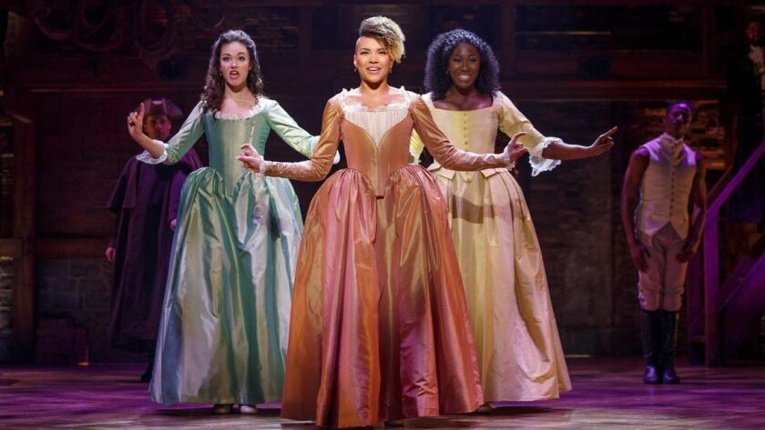 """Solea Pfeiffer, Emmy Raver-Lampman and Amber Iman (from left) in a scene from the touring production of """"Hamilton."""" (Joan Marcus)"""