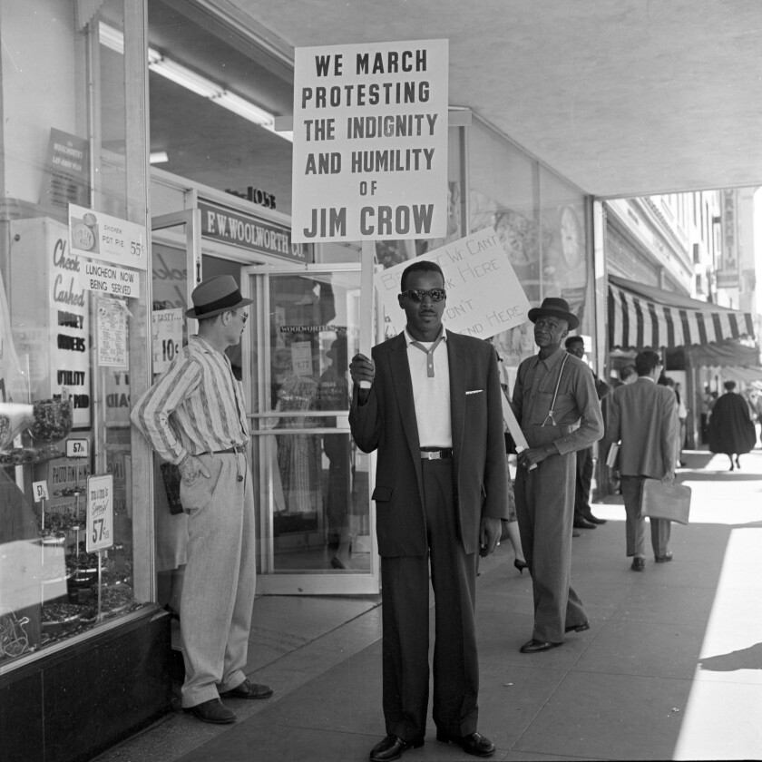 A man protests in front of Woolworth's storefront in downtown San Diego, 1960