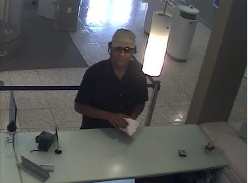 A surveillance camera captured this image of a man suspected of robbing a Citibank in Oceanside on July 26. Police have asked the public to help them identify the man.