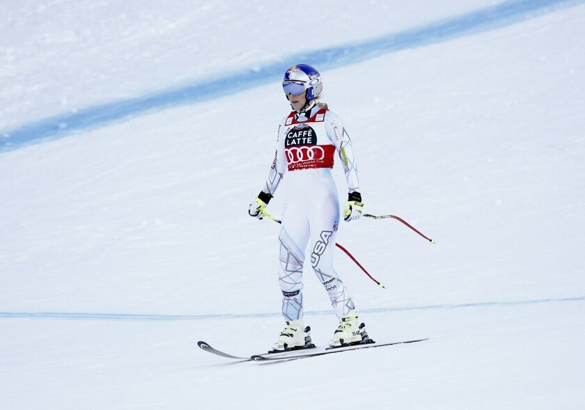 United States' Lindsey Vonn skis down the slope after crashing during a women's Alpine ski downhill race, in La Thuile, Italy, Friday, Feb. 19, 2016. (AP Photo/Alessandro Trovati)