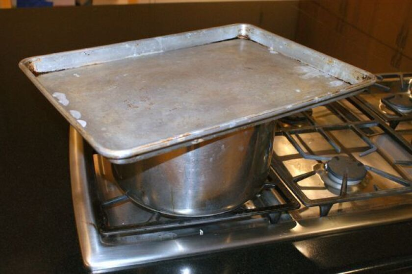Need to cover that pot fast? A baking sheet will work in a pinch.
