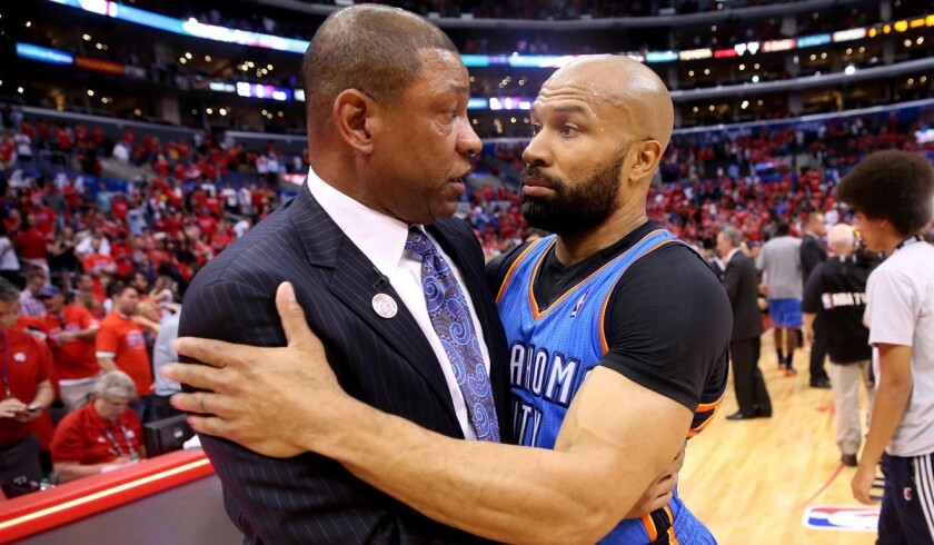 Derek Fisher, right, will not be joining the Clippers' Doc Rivers in the fraternity of L.A. coaches in the NBA.