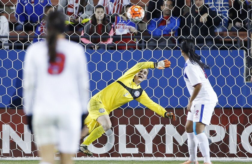 Puerto Rico defender Kelley Alexis Johnson (2) looks on as goalkeeper Karly Marie Gustafson (1) is unable to stop a shot for a goal from United States midfielder Samantha Mewis, not pictured, during the second half of a women's Olympic qualifying soccer match, Monday, Feb. 15, 2016 in Frisco, Texas