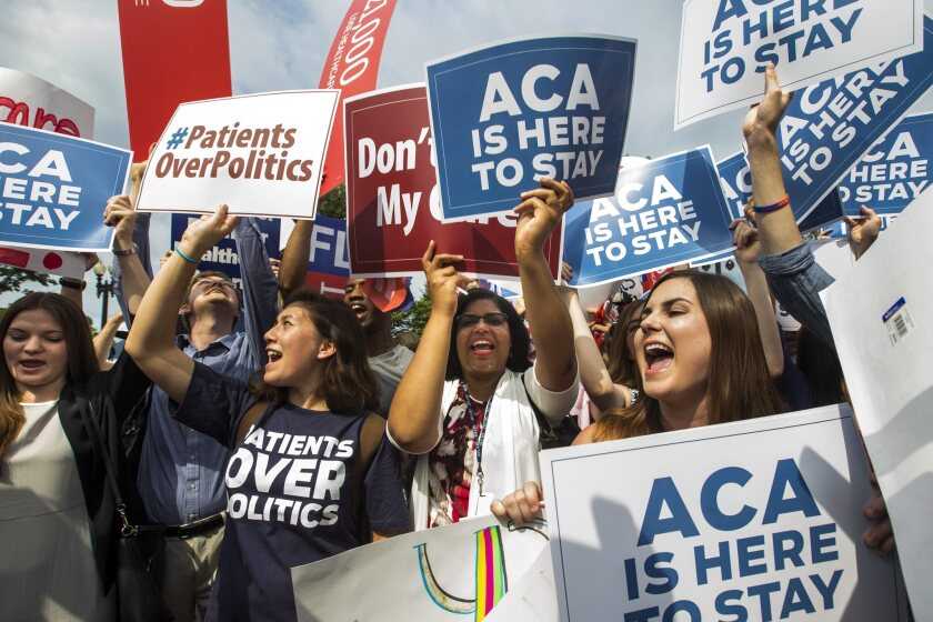 Demonstrators cheer outside the Supreme Court building after justices upheld nationwide premium subsisides under Obamacare in June.